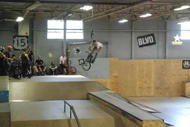 Jeff Gentry sends a barspin over the hip in Expert Park.