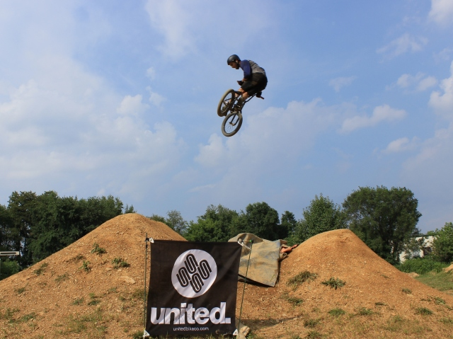 Evan Smedley with a big whip over the United banner.  (Photo: Nilo Hodge / ECD)