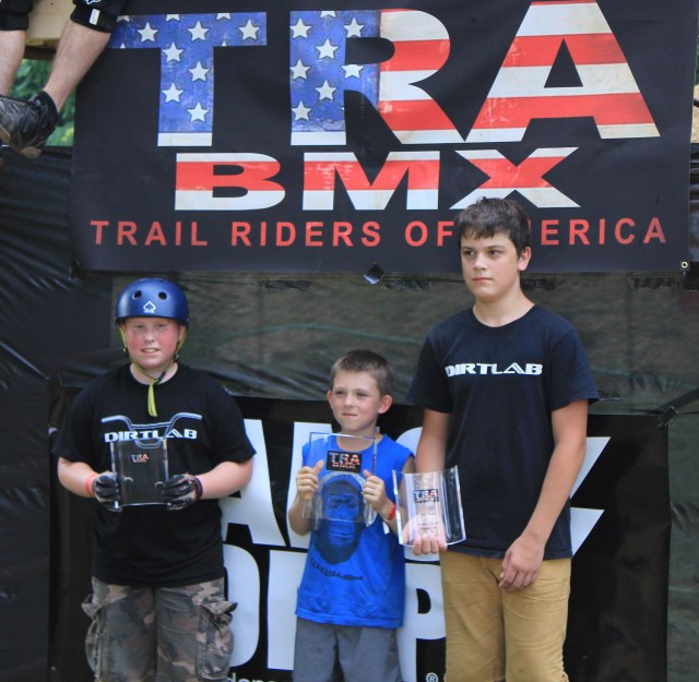 Beginner Dirt Podium: 1st place Rider Delfino (center), 2nd place Sawyer Sorrells (right) and 3rd place Nick Suhr (left).  (Photo: Nilo Hodge / ECD)