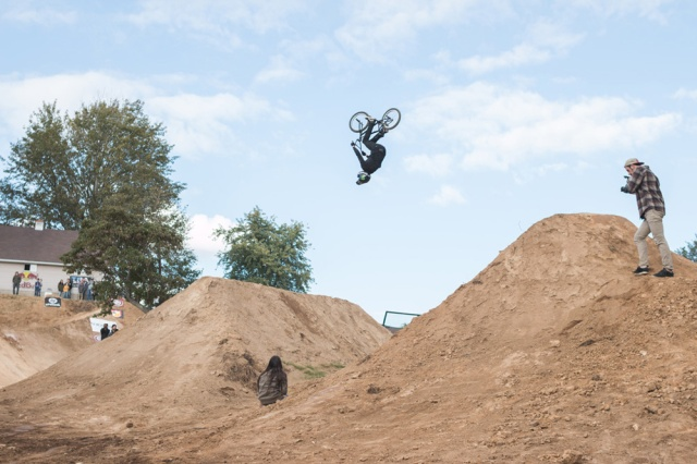 Scott Cranmer throwing a backflip over the banger set for 2nd place in the Dirt Jump Comp.  He had an awesome time racing too, throwing big smiles all day long.  Photo: Eric Silver