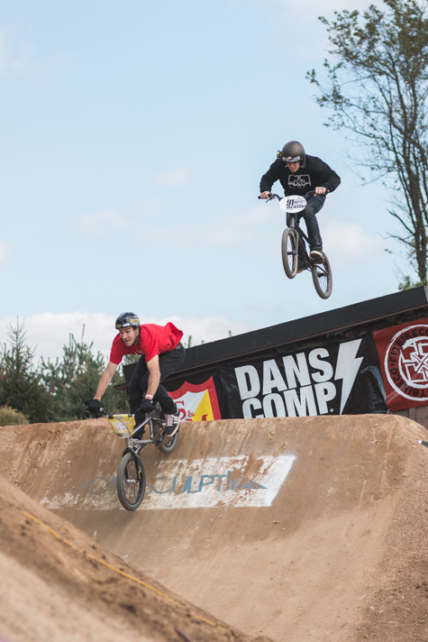 Chris Doyle leads Van Homan off the roof jump.  Photo: Eric Silver
